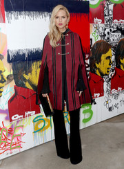 Rachel Zoe arrived for the Tommy Hilfiger show looking sophisticated in a striped wine-red cape.