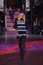 Devon Windsor was all about hip hop glamour in a sequined T-shirt dress and a matching beanie on the Tommy Hilfiger runway.