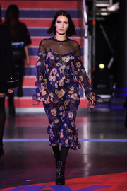 Bella Hadid walked the Tommy Hilfiger runway wearing a floral cold-shoulder dress, which was toughened up with a mesh top.