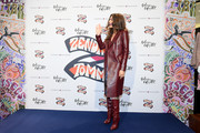 Zendaya Coleman rocked a wine-red leather coat and matching boots at the TommyXZendaya event.