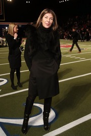 Nina Garcia sported an all-black wraparound skirt, turtleneck, and fur vest combo at the Tommy Hilfiger fashion show.