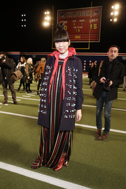 Susie Yu teamed an appliqued coat with a striped maxi dress for the Tommy Hilfiger fashion show.
