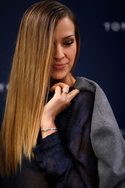 Petra Nemcova's hair was sleek and straight at the Tommy Hilfiger runway show. To recreate Petra's look, try a product like Phytodefrisant Botanical Hair Relaxing Balm and blow-dry. Next, flat iron section by section until smooth.