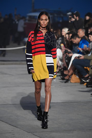 Joan Smalls looked vibrant in a long-sleeve color-block polo shirt while walking the Tommy Hilfiger show.