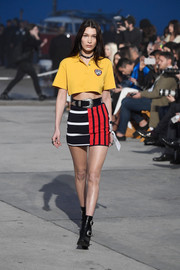 A contrast-striped mini skirt sealed off Bella Hadid's color-block outfit.