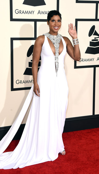 Toni Braxton Cutout Dress [red carpet,white,carpet,clothing,dress,gown,formal wear,flooring,shoulder,fashion,arrivals,toni braxton,grammy awards,staples center,los angeles,california,the 57th annual grammy awards]