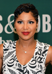 Toni Braxton looked like Betty Boop with her finger wave while signing copies of her book.