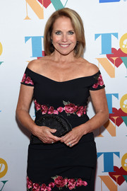 Katie Couric paired a beaded, fan-shaped clutch with an off-the-shoulder dress for Tony Bennett's 90th birthday party.