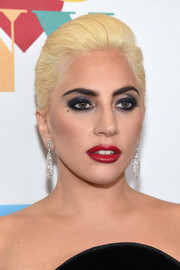 Lady Gaga added a high dose of sparkle with a pair of diamond chandelier earrings.