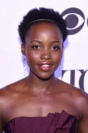 Lupita Nyong'o attended the Tony Honors cocktail party wearing her natural curls.