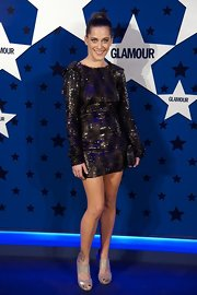 The full-length sleeves on Maria Leon's black sequined dress balanced the proportions of its super-short length.