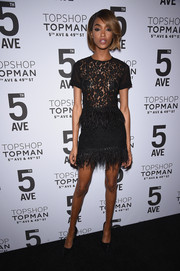 Jourdan Dunn went for a sultry match-matchy look with this Topshop feather-and-lace mini and blouse combo.