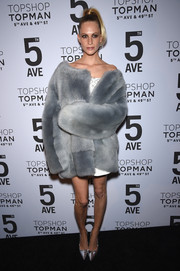 Poppy Delevingne made a grand entrance in a luxurious gray fur coat at the Topman New York City flagship opening dinner.