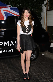 Miranda Cosgrove mixed feminine with edgy with a quilted leather skirt and heart-print tee.