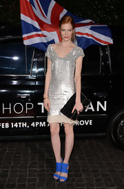 Jessica wore a slinky silver sequined dress to the Topshop opening in LA.