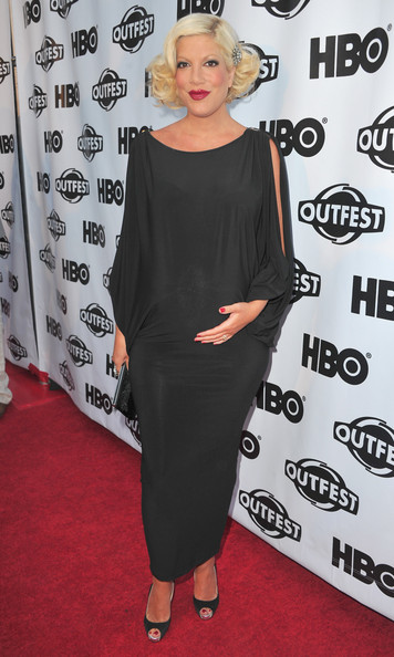 Tori Spelling Maternity Dress [clothing,shoulder,dress,red carpet,carpet,hairstyle,joint,premiere,footwear,little black dress,tori spelling,outfest opening night gala of gun hill road,california,los angeles,gun hill road,red carpet,outfest opening night gala]