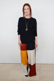 Julianne Moore jazzed up her simple sweater with a pair of color-block satin pants.