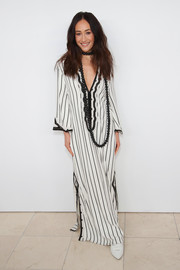 Maggie Q looked exotic in a black-and-white striped tunic dress by Tory Burch during the brand's Fall 2018 show.