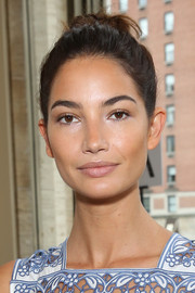 Lily Aldridge was fresh-faced at the Tory Burch fashion show wearing a casual top knot and minimal makeup.