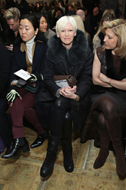 Joanna Coles toughened with with a pair of black moto boots for the Tory Burch fashion show.