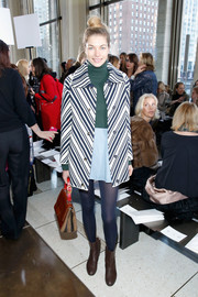 Jessica Hart oozed retro charm at the Tory Burch fashion show in a striped tweed coat layered over a turtleneck and mini combo.