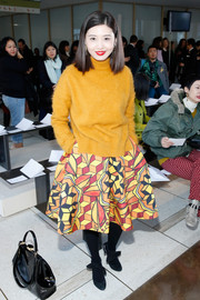 Christine Lau totally brightened up the place with her mustard turtleneck when she attended the Tory Burch fashion show.