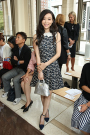 Zhang Jing Chu kept it dainty in a monochrome floral dress during the Tory Burch fashion show.