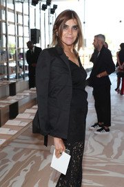 Carine Roitfeld attended the Tory Burch fashion show looking tough-chic in a black military jacket.