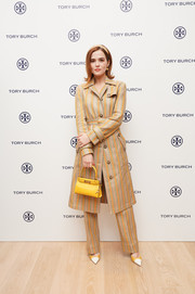 Zoey Deutch looked fab in a striped trenchcoat and matching pants at the Tory Burch Ginza boutique opening.