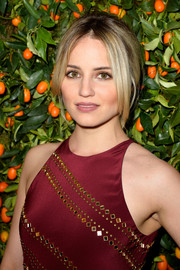 Dianna Agron swept her locks back into a loose ponytail for the Tory Burch Paris flagship opening.
