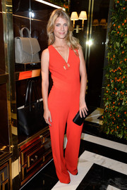 Melanie Laurent made an appearance at the Tory Burch Paris flagship opening wearing a bright red jumpsuit from the label.