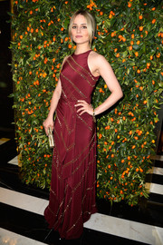 Dianna Agron looked downright regal in a mirror-embellished burgundy gown by Tory Burch during the brand's Paris flagship opening.