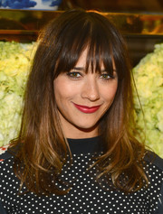 Rashida Jones looked cute at the Tory Burch Rodeo Drive opening with her wispy bangs and wavy ends.