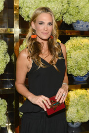 Molly Sims attended the Tory Burch Rodeo Drive opening carrying an elegant beaded red clutch.