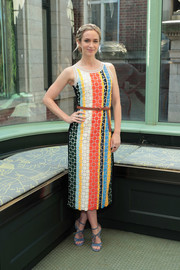 Emily Blunt looked vibrant in a multicolored striped midi dress by Tory Burch during the brand's Spring 2018 show.