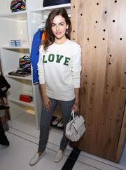Camilla Belle kept her feet comfy in stylish white loafers.