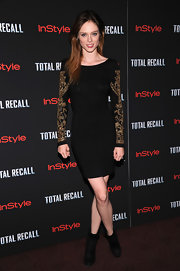 Coco Rocha looked fierce in her body con LBD with embroidered sleeves.