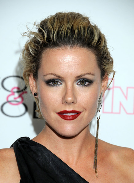 Kathleen Robertson arrived at  'InTouch Weekly's' 4th Annual Icons & Idols Celebration with smouldering eyes and rich red lips.