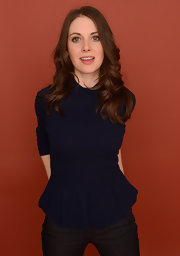 Alison Brie cut a girly silhouette in a navy knit peplum top during her 'Toy's House' portrait session.