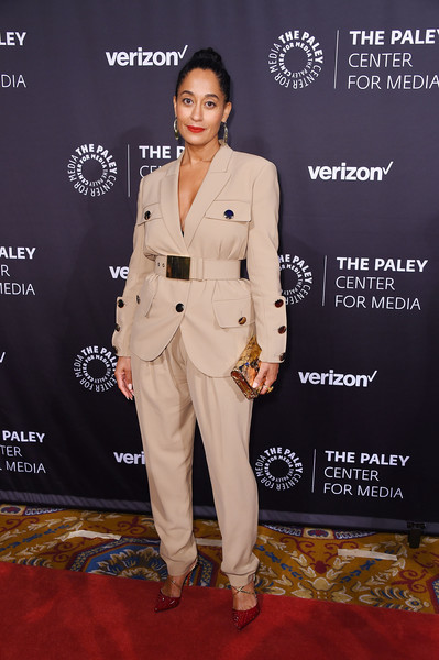 Tracee Ellis Ross Metallic Clutch [paley honors: celebrating women in television,suit,red carpet,clothing,pantsuit,carpet,formal wear,fashion,premiere,flooring,event,tracee ellis ross,new york city,cipriani wall street,the paley honors: celebrating women in television,event]