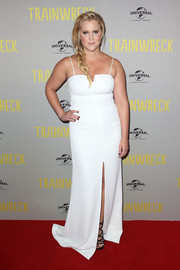 Amy Schumer slipped into a white Halston Heritage gown with spaghetti straps and a high front slit for the Australian premiere of 'Trainwreck.'