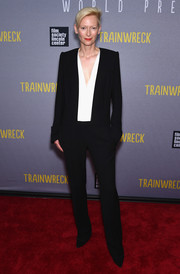 Tilda Swinton worked the 'Trainwreck' New York premiere red carpet in a mannish monochrome jumpsuit by Haider Ackermann.