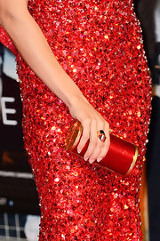 Rosario Dawson paired her red sequin gown with an equally bright and shiny, metallic red clutch.