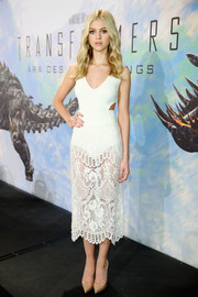 Nicola Peltz worked a sultry vibe in a white Stella McCartney bodysuit with side cutouts during the 'Transformers: Age of Extinction' press conference.