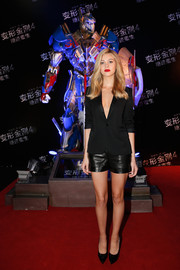 Nicola Peltz added a bit of edge with a pair of black leather shorts, also by Saint Laurent.