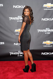 Gabrielle Union gave her lace dress a modern edge with black platform wedge boots with patent cap toes.