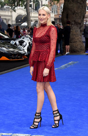 Stephanie Pratt made an appearance at the 'Transformers: The Last Knight' global premiere wearing a red peplum cocktail dress by Alexander McQueen.