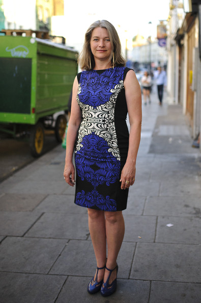 Kerry Fox looked classically stylish in this black, white, and purple printed frock.