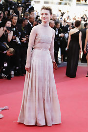 Mia looked elegant at the Cannes Film Festival in a high-necked chiffon evening gown the exact tone of her skin.