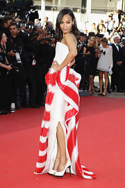 Zoe Saldana complemented her striking red and white strapless gown with white Nicholas Kirkwood pumps with black heels and platforms.
